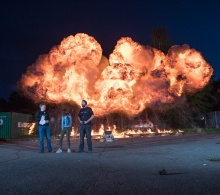 Artem SFX Supervisor and CEO Mike Kelt and Pyrotecnic Supervisor Toby Stewart chat with one of our guests as a fireball rages behind them.