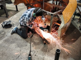 Grinding metal in workshop